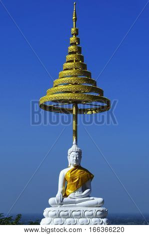 white buddha statue on blue sky in Thailand
