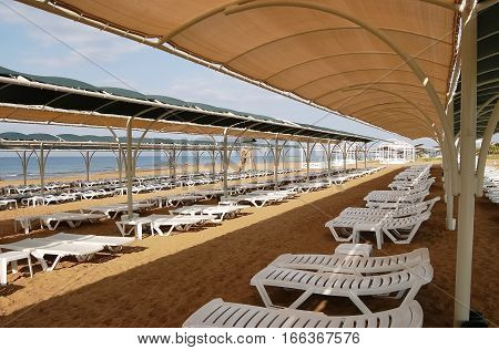 Sunbeds on the beach in Side on the Mediterranean coast of Turkey.