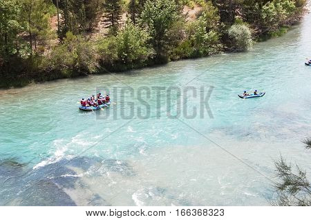 Rafting on the mountain river on inflatable boats in the Turkey.