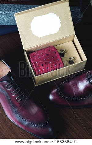 Close up picture of leather men's shoes on wooden background