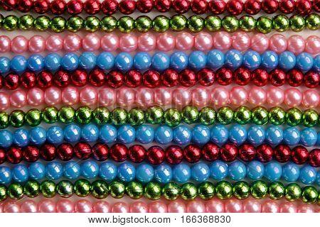 Background of large amount of madri gras bead background