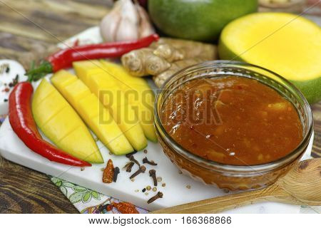 Bowl of homemade frsh Mango Chutney on old wooden table