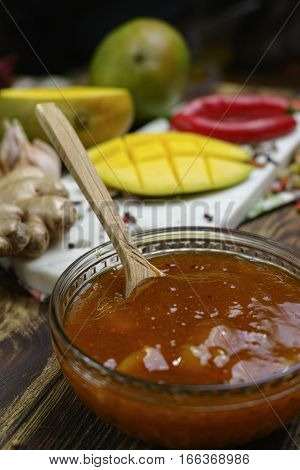 Bowl of homemade fresh Mango Chutney on old wooden table