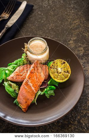 Baked Salmon With Green And Lemon On Ceramic Plate