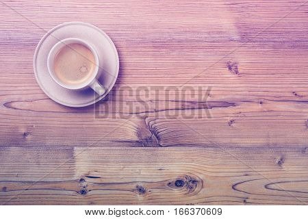 Cup of coffee on wooden vintage board background, cafe tabletop with copy space
