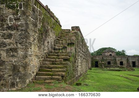 medieval fort stairs in Panama grown in with with moss