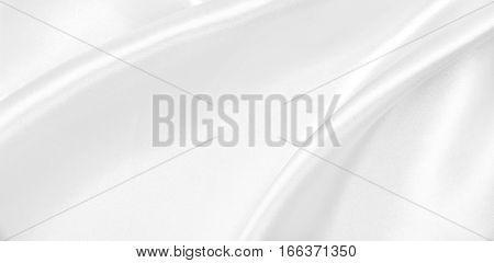 Smooth Elegant White Silk Or Satin Luxury Cloth Texture As Wedding Background. Luxurious Background