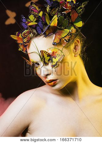 woman with summer creative make up like fairy butterfly closeup bright colored background, spring coming concept