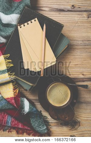 Cozy home coffee cup with plaid, warm details background, vintage filter