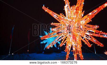 Christmas festive street illumination. Abstract bright snowflake