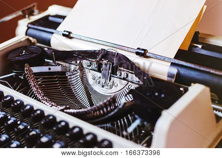 Retro old typewriter with paper sheet, close up photo