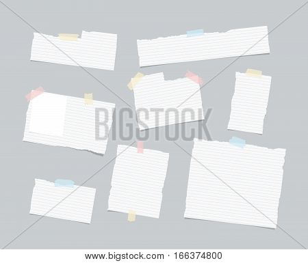 Ripped ruled note, notebook, copybook paper sheet, strips stuck with colorful sticky tape on light gray background.