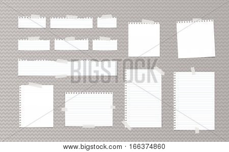 White note, notebook, copybook paper strips and sheets stuck with sticky tape on gray wavy pattern.