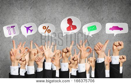 Many hands of businesspeople showing different gestures