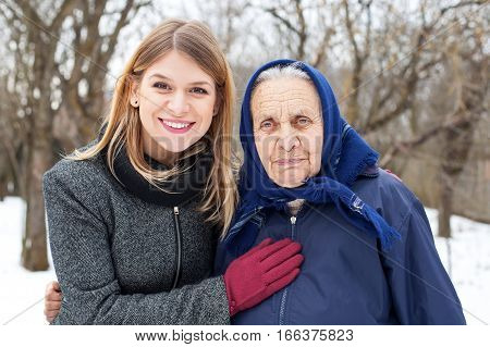 Picture of a beautiful female posing with her grandmother