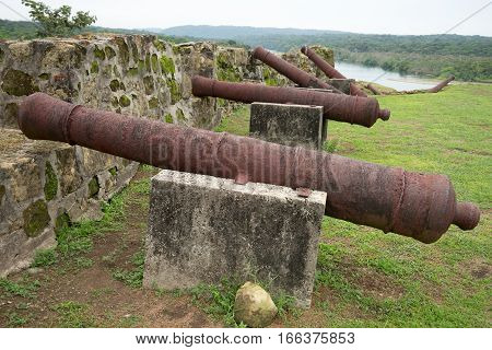rusty cast iron cannons in old Spanish fort in Panama