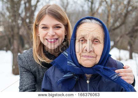 Picture of a senior woman with her cute caretaker outdoor