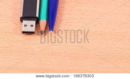 various office supplies flash card for storing information a pencil for writing and drawing
