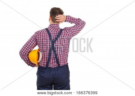 Picture of a young male engineer having a headache