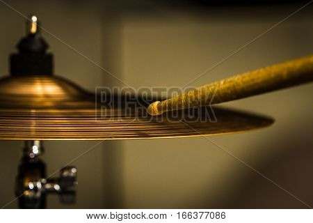 Plays A Drum Stick On The Hi-hat Or Ride Cymbal