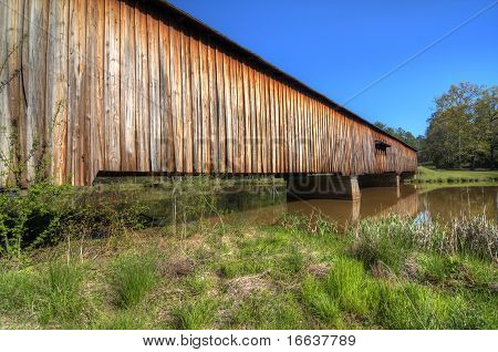 An historic covered bridge at Watson Mill Bridge State Park near Comer in Northeast Georgia USA. poster