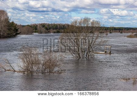 Flooding on the river during the spring flood. The raft broke and drifting downstream.