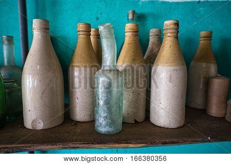 various vintage bottles from shipwrecks in Panama