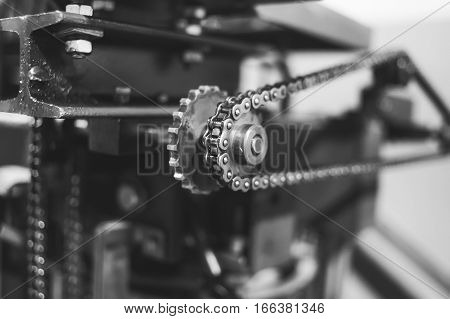 A sprocket or sprocket-wheel is a profiled wheel with teeth, cogs, or even sprockets that mesh with a chain, track or other perforated or indented material.