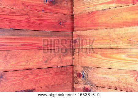 corner made from horizontal brown wooden boards