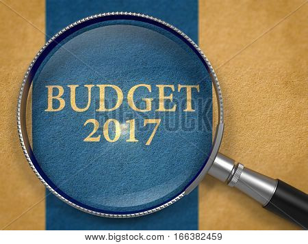 Budget 2017 through Lens on Old Paper with Dark Blue Vertical Line Background. 3D Render.
