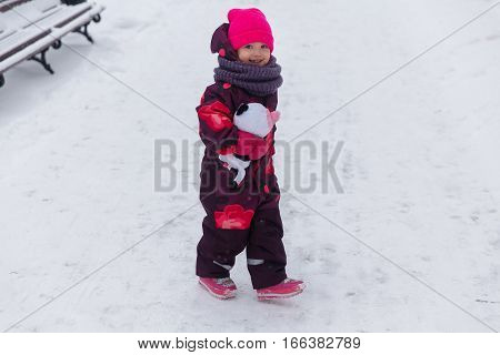 Small child on walk in winter park