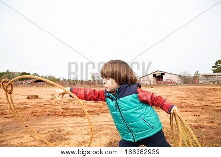 Toddler Boy Training Making Loope And Throwing Lasso In Ranch