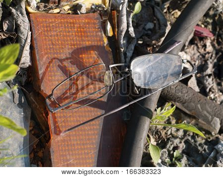 photo of a destroyed glasses on a rubbish dump
