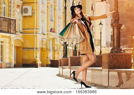 Happy shopping. Young beautiful girl with shopping.