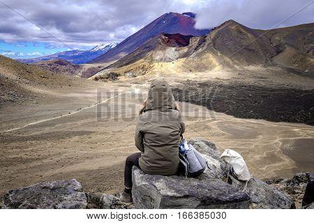 Woman Hiker Admiring Volcanic Landscape View Of Tongariro, New Zealand