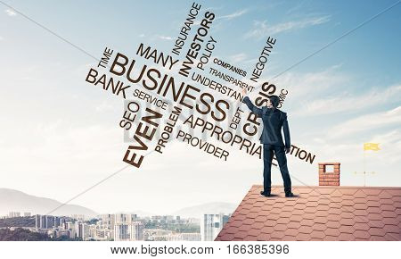 Businessman writing business related and success conceptual words. Mixed media