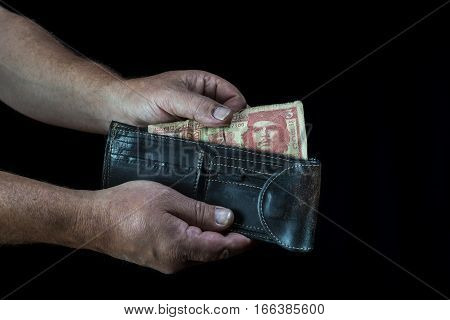 Taking A Three Cuban Peso Bill