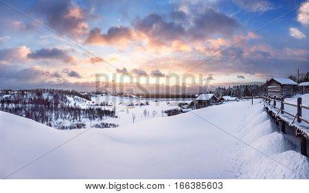 Beautiful winter sunset in Small Karelians near Arkhangelsk. Russia. Panoramic view.