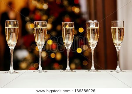 five glasses with a cool delicious champagne or white wine at the event catering