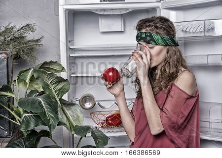 Pretty Hippie Girl In Bandana Drink From Glass