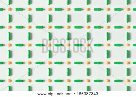 Medical Pills And Capsules Pattern On White Background. Flat Lay, Top View.