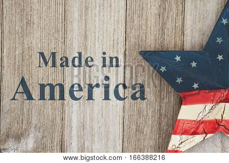 Made in America message USA patriotic old flag on a star with weathered wood background with text Made in America