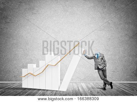 Headless businessman leaning on growing bar graph