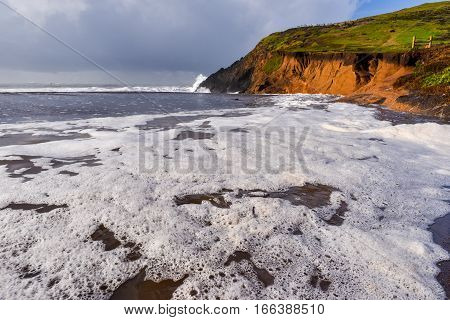 Stormy Weather By A Cliff At Beach