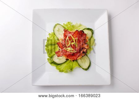 Meat Chips And Cucumber On A White Background