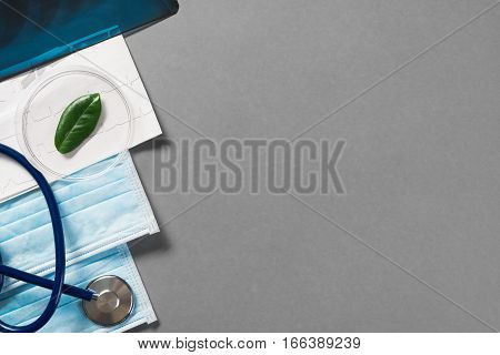 High angle shot of medical items on gray surface