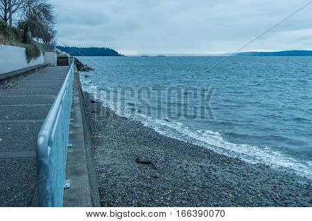 A view of a seawall walkway in West Seatle Washington.
