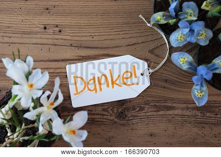 Label With German Text Danke Means Thank You. Spring Flowers Like Grape Hyacinth And Crocus. Aged Wooden Background
