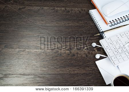 Business items notepad and stationary on wooden table