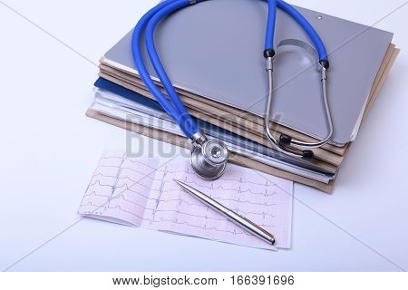Closeup of stethoscope, red heart on a rx prescription and phone.